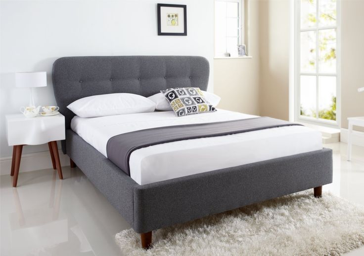 Looking for something different that is still bang on trend? The retro inspired Oslo Bed Frame is designed around a modern take on an old classic.    Upholstered in a grey wool look fabric, the Oslo combines soft elegant curves and buttoning to create a design which is inspiring in its simplicity.    The bed comes complete with a quality sprung slatted base system and is available in both Double and King Size.  The distance from the floor to the top of the slats where the mattress sits is…