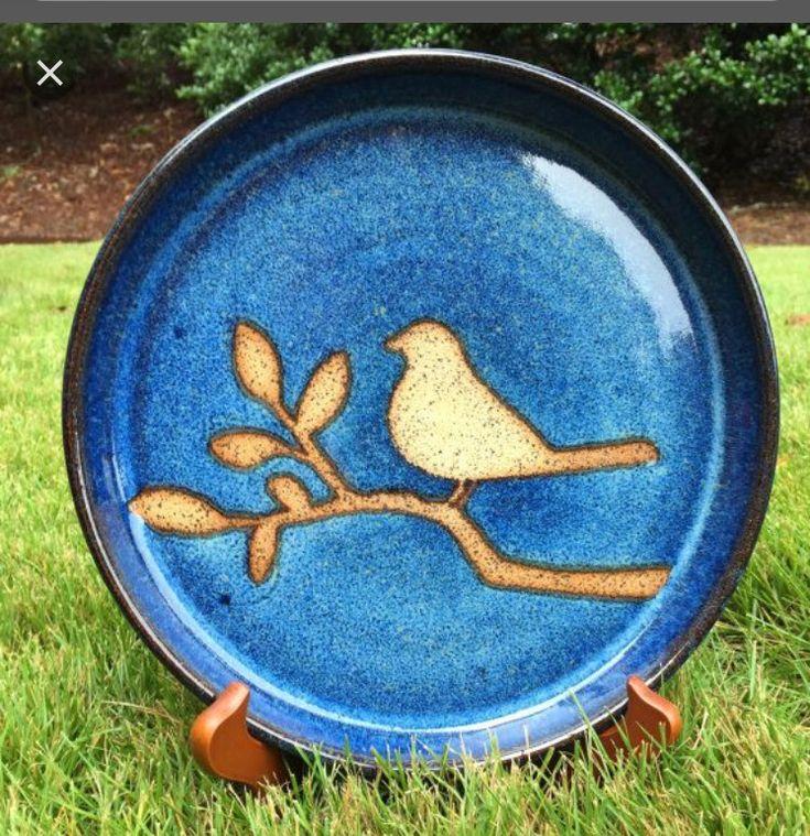 Bird on blue stoneware plate.