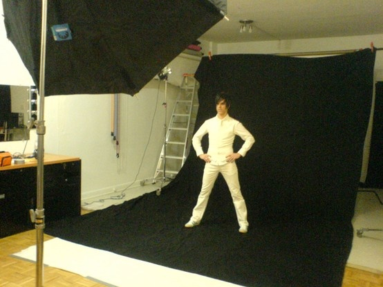 Behind-the-scenes at a photo shoot.  Chris, he's all white.