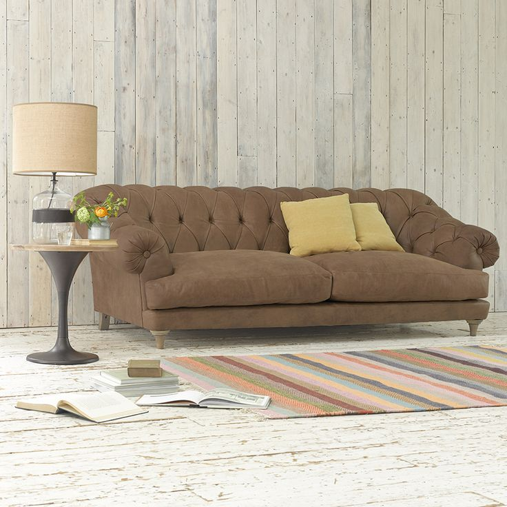 "BAGSIE SOFA in Walnut beaten leather. ""Bagsie one of these!"" we all cried when we made the first one. Our very own version of the classic chesterfield, this deep-buttoned beauty is one sumptuous sofa. #sofa #leather #livingroom"