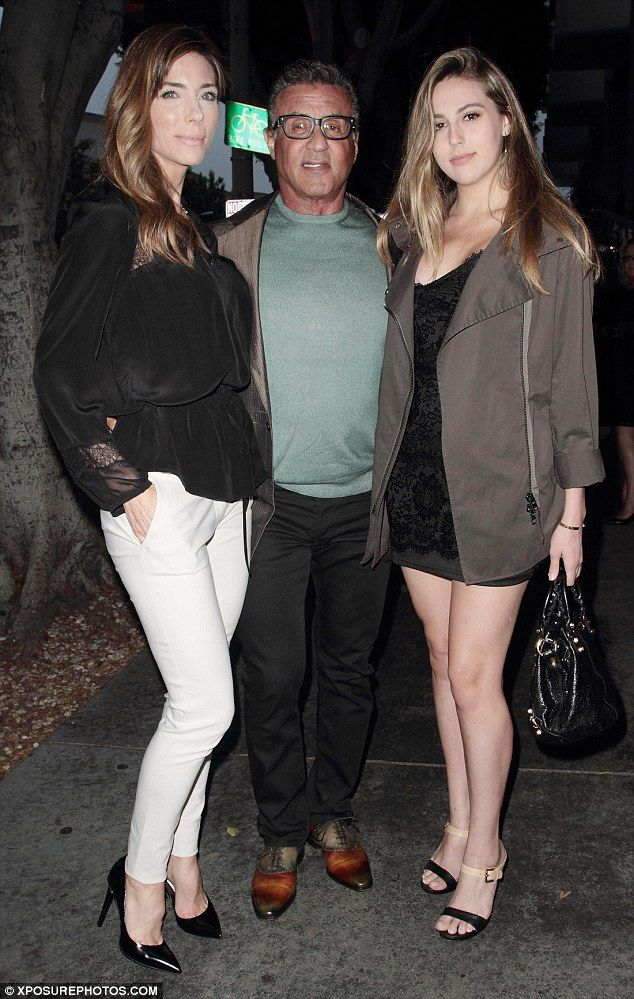 Family guy: Sylvester Stallone, 69, cosied up to his wife Jennifer Flavin, 47, and daughter Sophia, 19, on a family night out in Hollywood on Tuesday