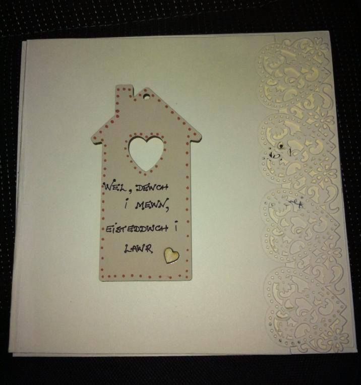 New home card in Welsh. it says 'Well, come in, and sit down' and is a line from a traditional folk song about a little house.