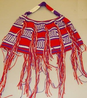 "Bilum (Tok Pisin), waghl tapi (Kaguhl language), string bag made of wool.  ""Madang style"" design; alternate squares of red, and purple with white diagonal lines; horizontal bands of white and purple; vertical tassles of red, white and purple. Part of the British Museum Collection"