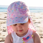 Baby Candy Legionnaire - quick dry microfibre. The hat is pink with a heart, flower & butterfly patter in the visor, front panel & back flap. There is an elasticised towelling band that ensures comfort & fit for most babies.