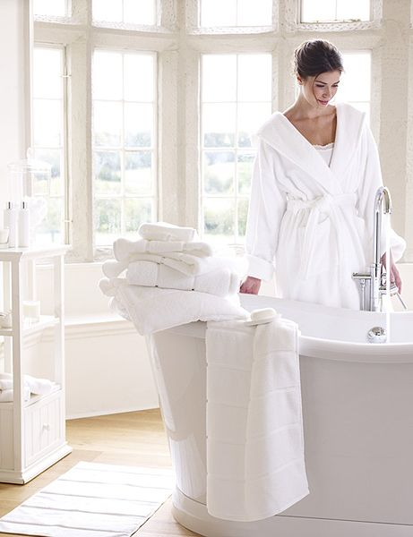 Fluffy white egyptian cotton towels and a cosy robe - so luxurious