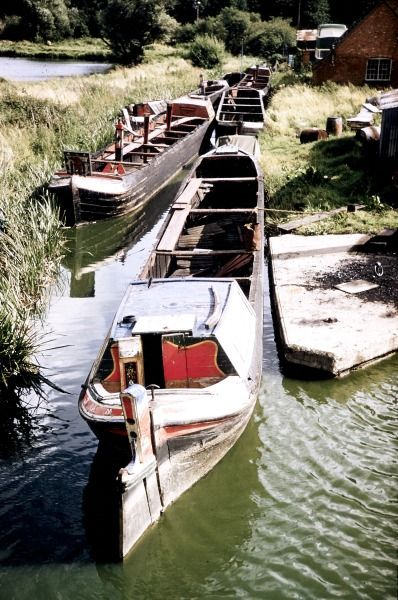 """BW197-2-26-29 the Barlows Arm at Braunston with six abandoned boats incuding the butty """"Jane"""""""