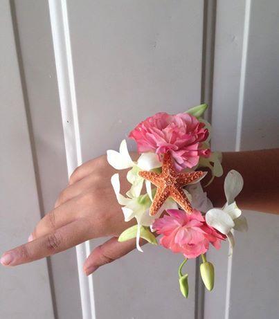 CBL138 Riviera Maya Weddings bodas / Starfish, coral ranunculus and orchid corsage
