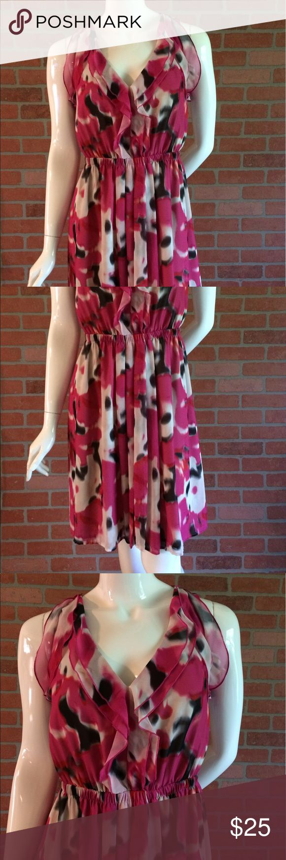 Sleeveless Loft Dress Pink Cream Black EUC Beautiful sleeveless dress by Ann Taylor LOFT. Size 0. Elastic waist. Colors are Pink Cream & Black. Has 2 large ruffles at the neck line. Chest is 17 inches from armpit to armpit. Waist is 12.5 inches unstretched.  Length is 37.5 inches from top of shoulder to bottom of dress. Shoulders are 11 inches across.  Very light and flowy. Fully lined.  Shell is 100% polyester lining is 100% polyester.  Machine wash cold tumble dry low. Ann Taylor LOFT…