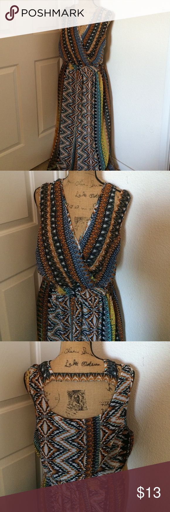 Tribal Maxi Dress 2X Worn only once. Tribal dress maxi dress in 2X. Fully lined • Hidden cinched waist • Figure Flattering Feel free to ask any questions Dresses