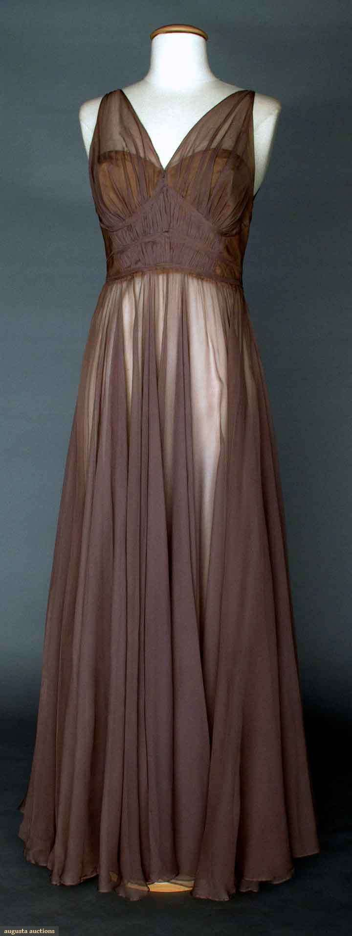 """VALENTINA MAUVE EVENING GOWN, 1930s Unlabeled & bought at Valentina Schlee's personal estate sale # Christie's East, 1992: silk chiffon goddess gown, deep V-neckline F & B, sleeveless, above high waistline bodice fabric's gathers held in place by 3 narrow bands, silk bodice lining, hand finished details, B 34"""", W 25.5"""", L 58"""""""