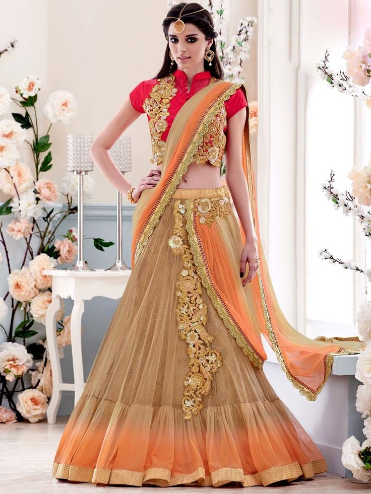 Impressive peach and beige color lehenga saree fabricated on net with sequins, zari, kundan work. Item code: SAV3906 http://www.bharatplaza.com/new-arrivals/sarees.html