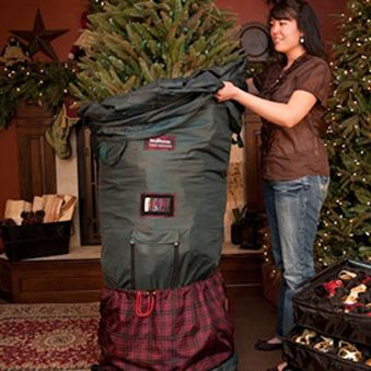 this great treekeeper includes a heavy duty rolling tree stand that allows you to roll the tree into storage both laterally and leaned to the side - Christmas Tree Bag Storage