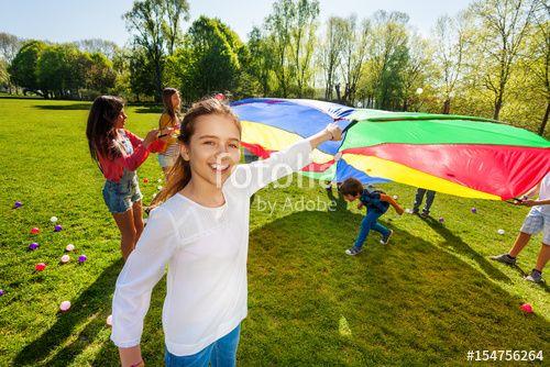 """Laden Sie das lizenzfreie Foto """"Girl playing parachute together with her friends"""" von Sergey Novikov zum günstigen Preis auf Fotolia.com herunter. Stöbern Sie in unserer Bilddatenbank und finden Sie schnell das perfekte Stockfoto für Ihr Marketing-Projekt!"""