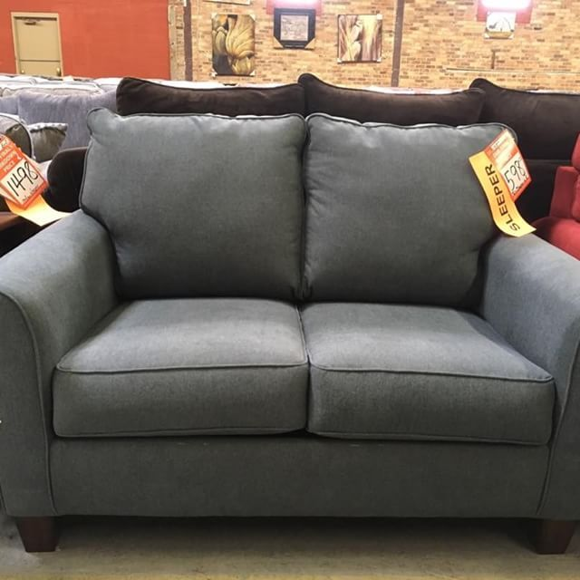 Ideal for that college apartment: a twin bed sleeper / loveseat by Ashley on grey or brown--originally priced$1318, NOW JUST 598!