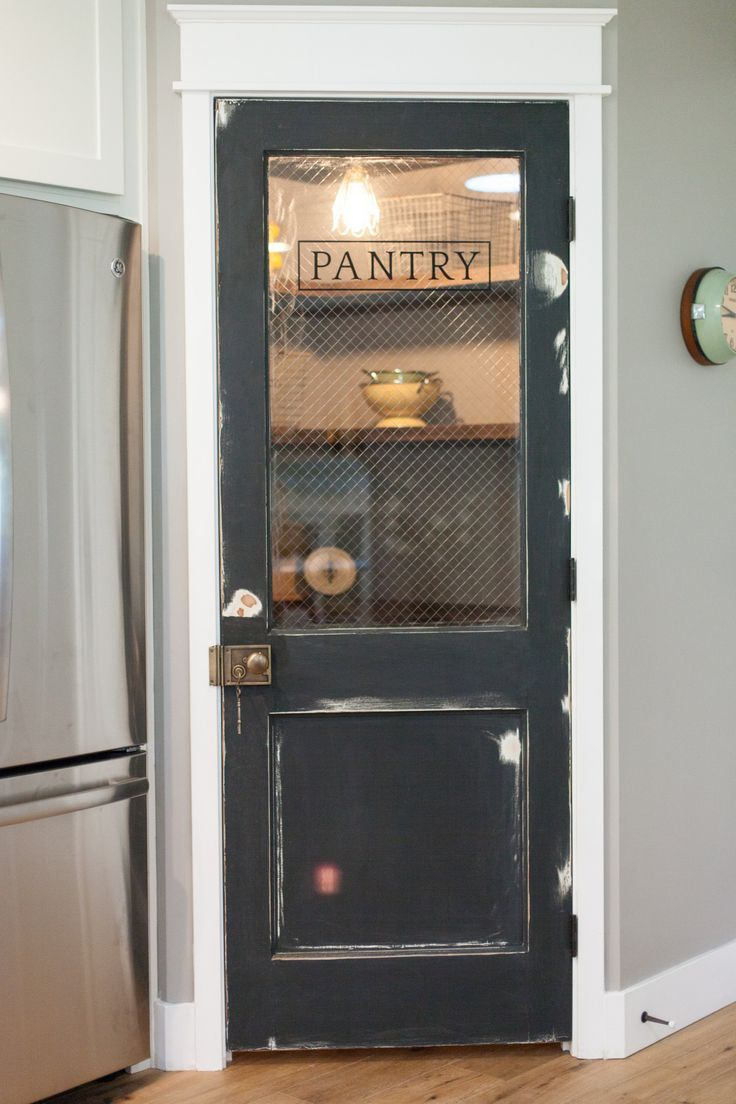 antique door pantry/ Closet, doesn't look too spacious but would like to see a split door for access above to keep small kids out,maybe drawers to meet the forward reaching...