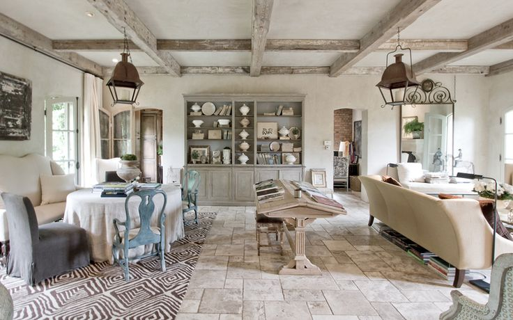 Living room with stone floors and beams