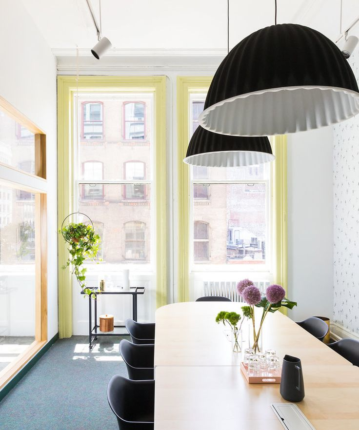 Statement lighting in a conference room inspo for a cool dining room