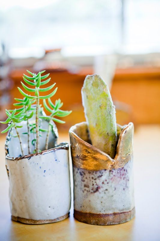 Two of my favorite things - cacti in handmade clay pots.  Now I know what to do with those ugly little pots I made back in college.