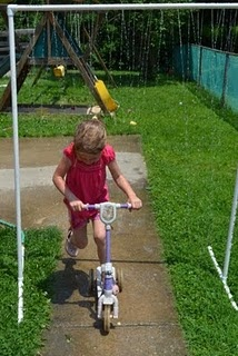 How FUN & simple is this!? A sprinkler made out of PVC pipes!