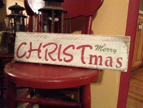 Merry CHRISTmas. This sign is made from reclaimed wood and would look great anywhere in your home for the holidays! Cream background with
