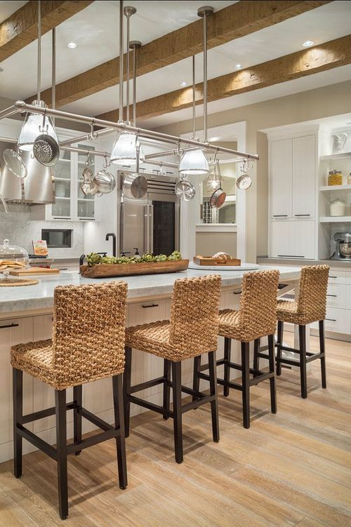 HomeBunch features this kitchens with multi textures and layers where wicker, marble and stainless steel make a perfect pairing.
