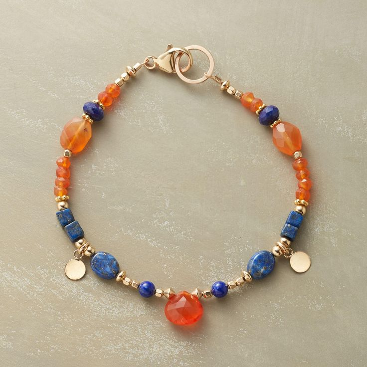 """CIRCLE OF STONES BRACELET--Bright orange carnelian and deep blue lapis in different shapes and sizes, accompanied by 14kt goldfill beads and dangling disk charms. Lobster clasp. Exclusive. Handcrafted in USA. Approx. 7-1/2""""L."""