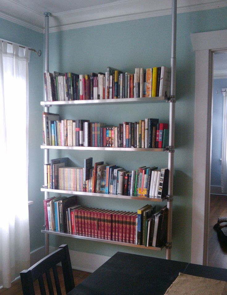 Tension shelving.... obsessed! I need to figure out a way to mount our bikes with tension poles & hooks, otherwise I know I'm going to run into them one doom-full night.