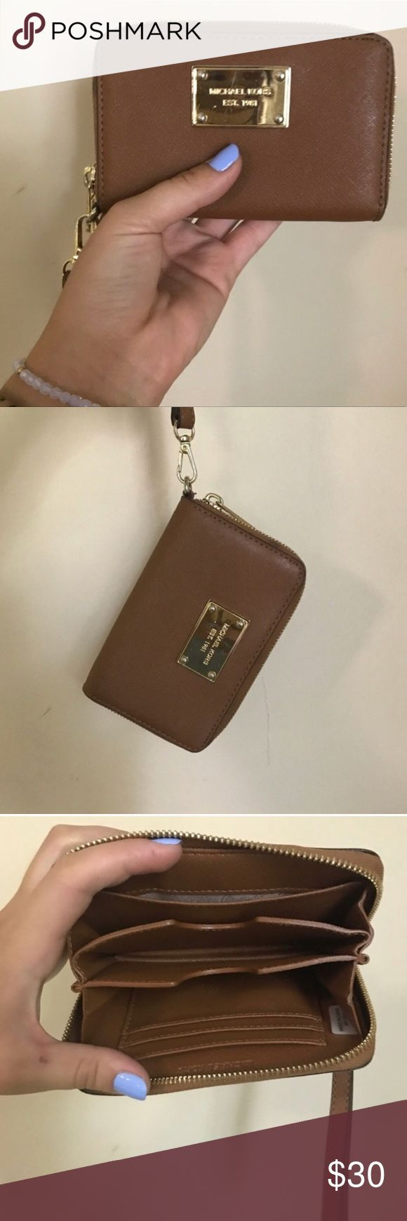 •brown michael kors wristlet wallet• Gently used Michael kors wristlet wallet. Last photos show wear areas. Few scratches on plate and black mark on back. Michael Kors Bags Clutches & Wristlets