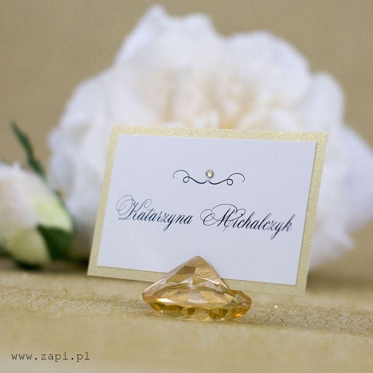 Bardzo elegancka złota winietka, umieszczona w kryształowej podstawce