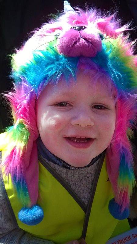 BRIGHT AND FUN with this rainbow fur hat no matter  what your age that!