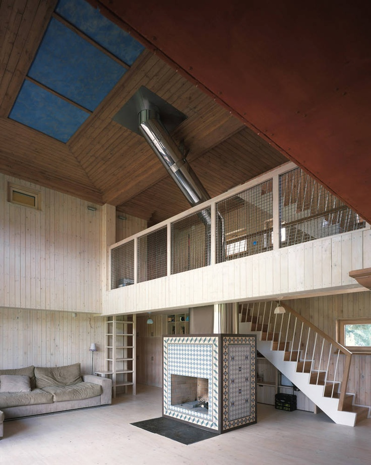 House in Tarussa / Bureau Alexander Brodsky     Interesting Wood Interior, The Couch could be a lot better.
