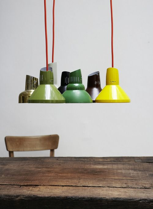 grouped industrial pendants over the bench. coloured cords.