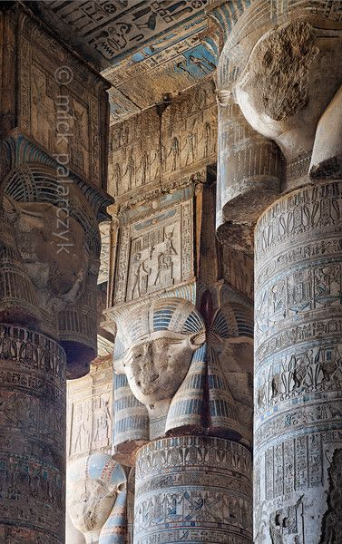 """[EGYPT 29517]<br /> 'Hathor headed columns in Dendera.'<br /> <br /> The columns in the outer hypostyle hall (or pronaos) of the Hathor Temple at Dendera are crowned by four-sided capitals carved with the face of the cow-eared goddess. The faces symbolize the four cardinal points of the universe and stress the universal character of the sky goddess Hathor, who was also called """"Lady with the four Faces"""".<br /> The square structure that is placed on top of the actual face is a sistrum, a…"""