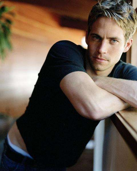 Young Paul Walker in Black T-Shirt and Jeans Leaning Pose