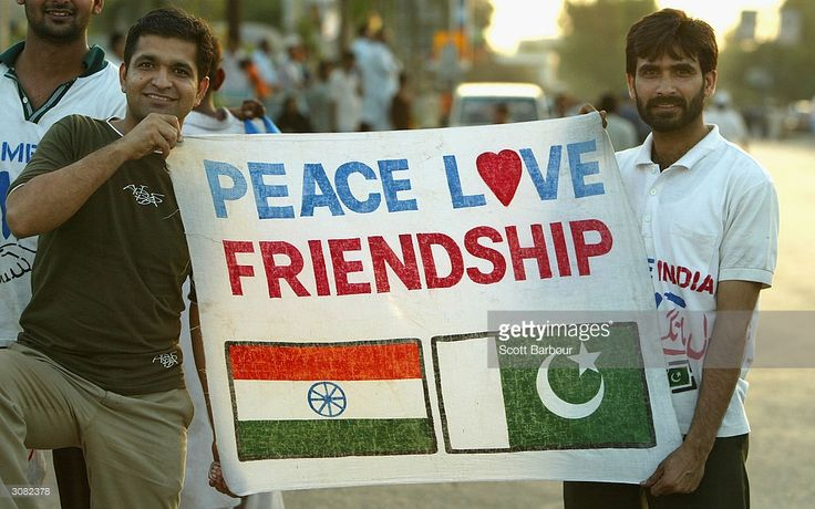Cricket fans hold a sign which says 'Peace Love Friendship' after the first Pakistan v India one day international match played at the National Stadium March 13, 2004 in Karachi, Pakistan. It is the Indian teams first full tour of Pakistan in almost 15 years, comprising five one-day internationals followed by three Tests. The tour is seen as evidence that the two nuclear-armed rivals are getting closer after almost going to war over the Himalayan region of Kashmir less than two years ago.