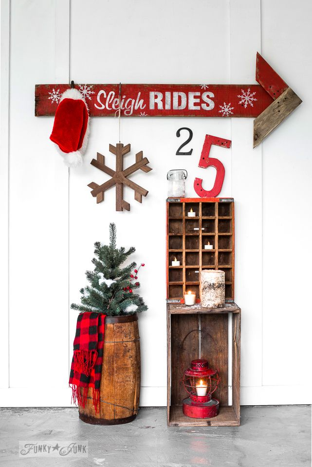Reclaimed wood Christmas Sleigh Rides arrow sign, made with Funky Junk's Old Sign Stencils and Fusion Mineral Paint | funkyjunkinteriors.net.