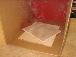 Lazy Susan inside a box to rotate things as you're spray painting them. Brilliant.