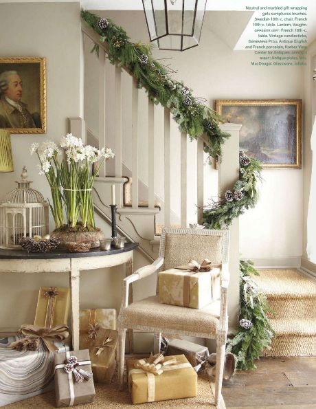 garland on banister, paper whites, packages   |   Veranda Magazine via Splendid Sass: