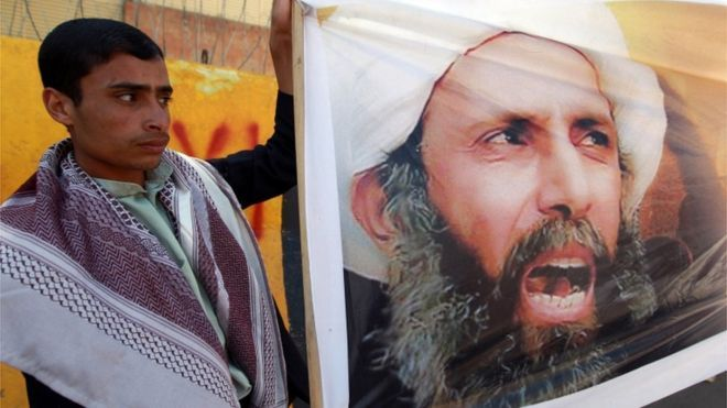 Sheikh Nimr al-Nimr: Figurehead Shia cleric 2 January 2016. A file picture taken in the Yemeni capital Sanaa on October 18, 2014, shows a protester taking part in a demonstration outside the Saudi embassy against the death sentence on Saudi Shiite cleric and anti-government protest leader, Nimr al-Nimr (portrait), after he was convicted by Saudi authorities of sedition.