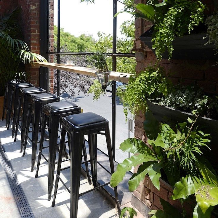 Chantelle & Steve Balcony | The Block Shop  The timber plinth and black stools