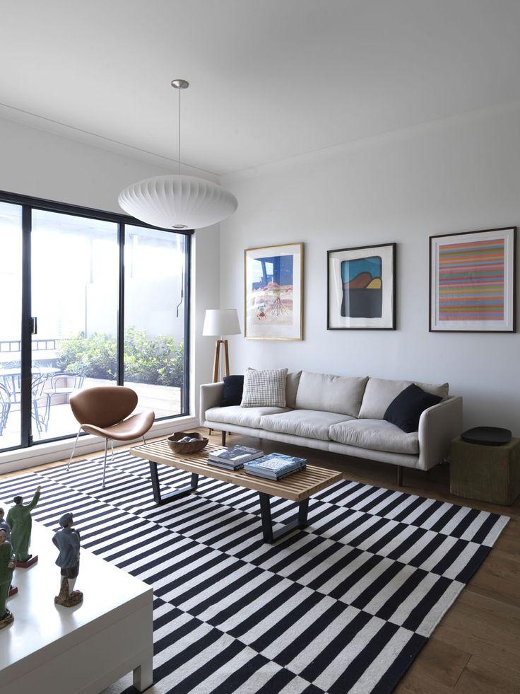 STEEPLE APARTMENT | alwill  #pendant #interiors #livingroom #rug #wood #artwork #view #bifolddoors