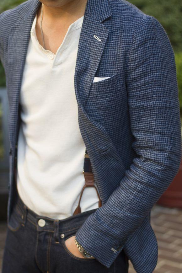 Shop this look on Lookastic:  https://lookastic.com/men/looks/blazer-henley-shirt-skinny-jeans-suspenders-watch/12660  — White Henley Shirt  — Navy Houndstooth Wool Blazer  — Brown Suspenders  — Silver Watch  — Black Skinny Jeans