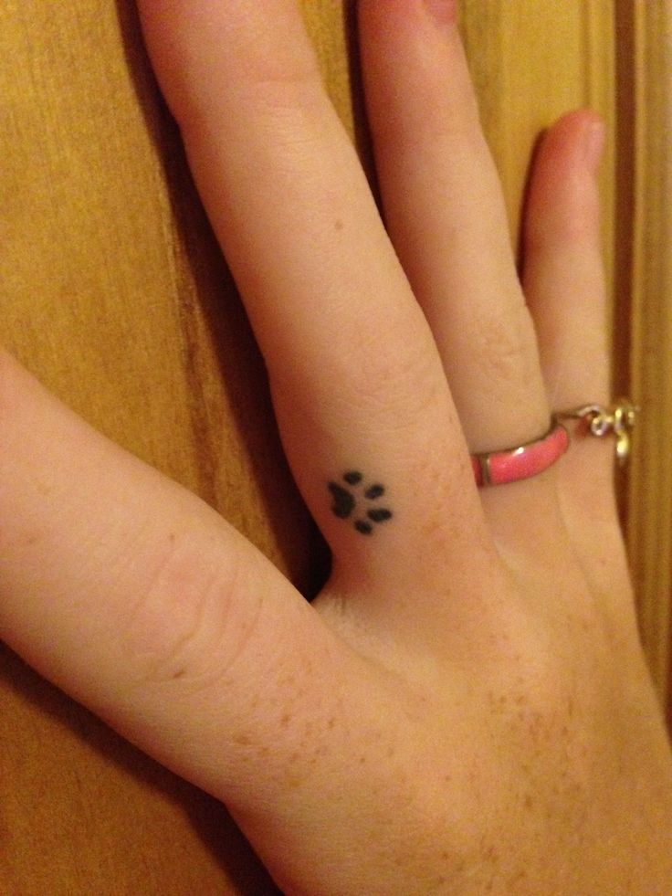 Small finger tattoo. Paw print