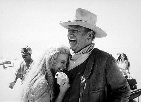 John Wayne and his wife, Pilar, at home, 1972.
