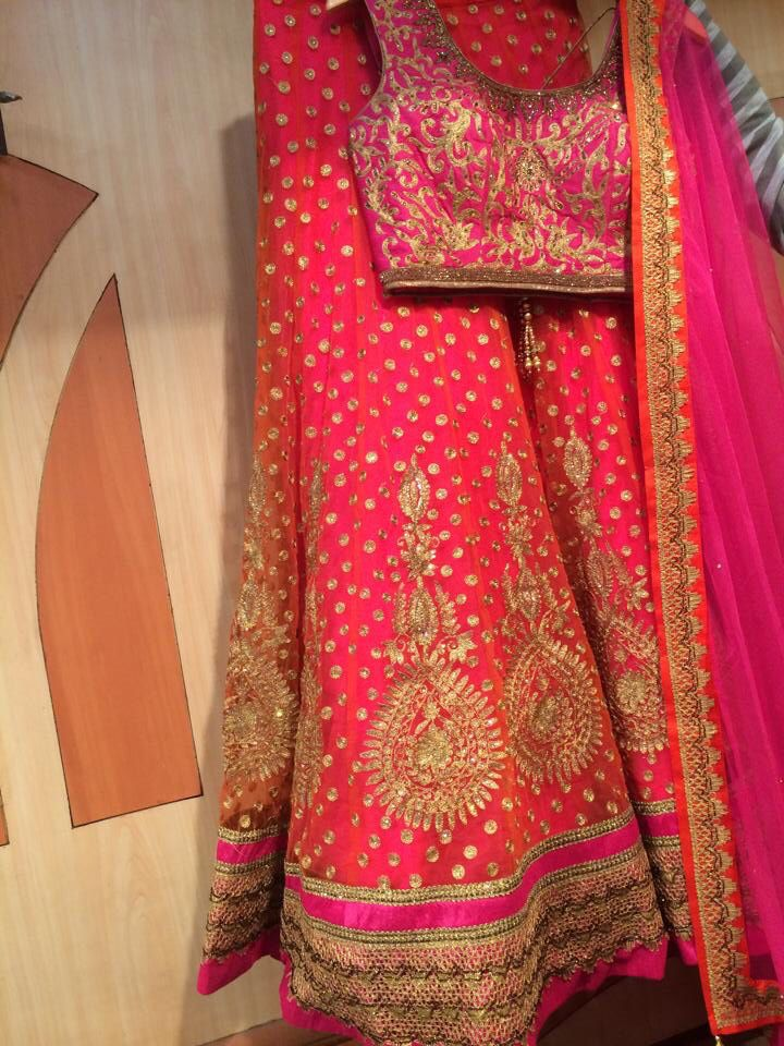 This bold and beautiful pink and gold lehnga by Madaan Cloth House, Phagwara is everything!