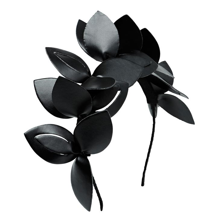 Leather look laser cut headpiece. Synthetic.