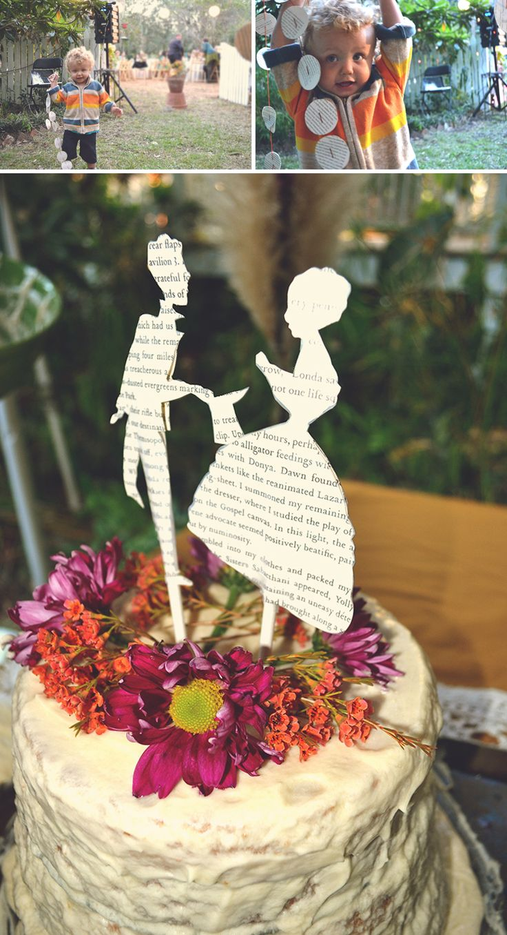 Cake topper of flowers, silhouettes cut out of books.