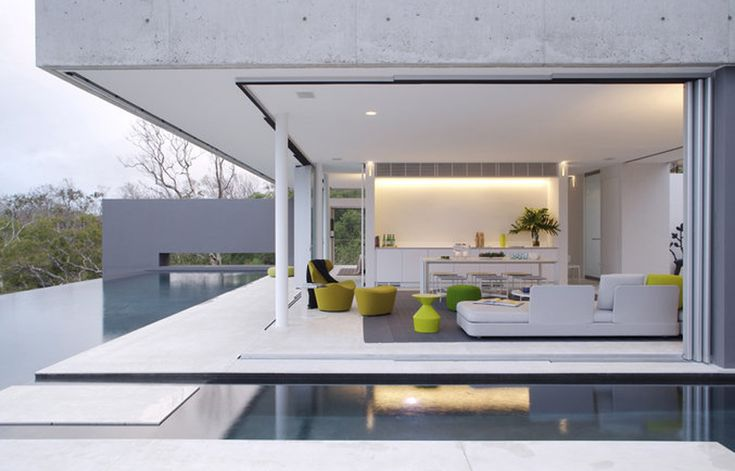 Love how the pool encloses both sides of the room