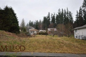 6667 Drake Street Powell River BC – Landscaped and serviced lot – Landscaped and serviced gently sloping in town lot is ready to build on.  Prepaid service connections, rear lane access and landscaped with fruit trees.  Situated one home back from D. A. Evans Park and Playground, short drive to lake and grocery store and a 5 minute drive to all other amenities.  No HST