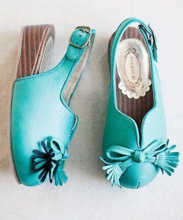 Joyfolie Raleigh Shoe Now THESE are Elsa shoes .. Love this Aqua Blue Raleigh Clog & Hair Clip Super cute aqua blue clogs have a wedge heel and an adjustabl